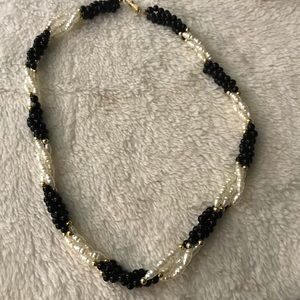 Black and white swirling faux pearls choker.